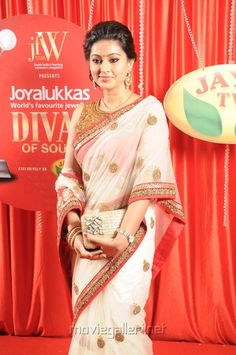 Checkout south indian actress sneha in beautiful designer netted saree with kundan work motifs on the saree and border work and paired. Indian Look, Indian Wear, Sneha Actress, White Saree, Perfect Figure, Net Saree, Latest Sarees, South Asian Wedding, Saree Dress