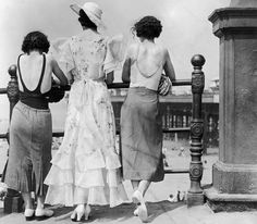 Three women on Blackpool promenade, one of the most famous seaside resorts in the UK, during a heatwave in 1934. One wears a divided skirt and the other a straight skirt, both over swimwear. The middle one has a 'copy' of the Letty Lynton dress made popular by Joan Crawford in the film of that name. Adapted for the mass market the triple row of frills at the hem are matched by frills at the shoulder forming cap sleeves. (E. Dean/Getty Images)