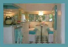 This is an adorable take on 50's decor in a camper.  Looks fresh, bright and cheerful!