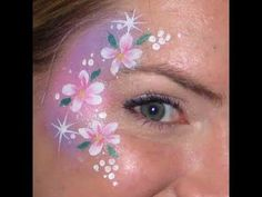 Super fast flower cheek art!  Products used were Diamond FX white, Wolfe Brothers Metallic purple, Wolfe Brothers Metallic green, and Silly Farm glitter.  Enjoy!