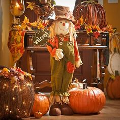 Celebrate Autumn with our Welcome Harvest Scarecrow! He's free-standing and comes dressed in olive overalls holding a leaf-shaped Welcome sign! #musthaves #kirklands #harvest