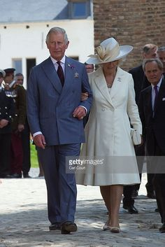 Britain's Prince Charles, Prince Of Wales and his wife Camilla, Duchess of Cornwall, leave through the North Gate of Hougoumont Farm after the opening following the farm's restoration on June 16, 2015 in Waterloo, Belgium.