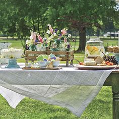 """Outdoor Table Setting w/ Bouquets in Old Jars set in Old Wooden Box.  Like the blue cake plate.  from """"Southern Living"""""""