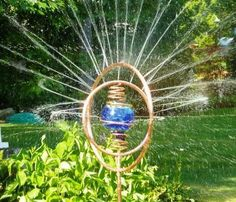 Revolving, spinning, Hand made, beautiful and functional, artisan water sprinklers for garden and yard made of polished copper and colorful blown glass