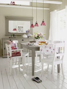 white dining room with gray furniture; white floor; cheerful red accents; I love that youth chair