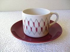 Mexico pattern, coffee can and saucer from the cook and serve range c.1960. This range of elegant ware was Crown Lynn's answer to the Scandinavian designed crockery such as Rorstrand which were met with great popularity.