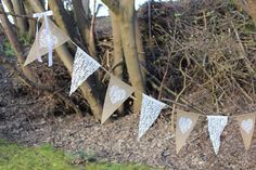 Burlap and lace bunting, banner, flags with white lace hearts. Rustic or vintage hessian wedding decoration, anniversary or engagement decor