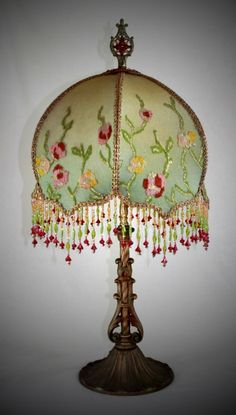 """Exquisite Antique restored iron lamp base from the 1920s features hand-sewn silk lined shade, ombre dyed bronze into light olive. Covered with an extraordinary metallic and embroidered antique textile - was a Victorian table covering - heavy hand beaded fringe - 27"""" to top of final. This lamp is large, heavy, and a real stunner - one of a kind artisan hand made work of art"""