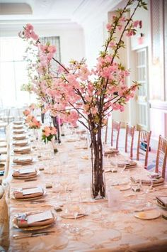 Cheery cherry blossoms make the prettiest pale pink centrepieces at this @Mandy Dewey Seasons Hotel Boston wedding.