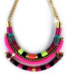 Multi layer necklace tribal inspired with a variarety of pink and dark rasperry tones    Two layers with a deliciate hand stich colorful threads and