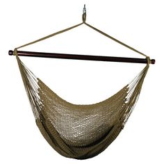 Curl up with your favorite novel and a crisp lemonade in this oversized hammock chair, showcasing a spreader bar design and woven tan-hued rope....