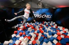 """Pepsi at Lollapalooza: Pepsi brought its """"Zero Chill House"""" to festival grounds. The fun-house-style activation invited guests to jump into a pit of foam blocks in the soft drink's signature hues; guests could also grab prizes."""