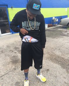 Currensy Wearing the Yellow Nike Air Max Zero