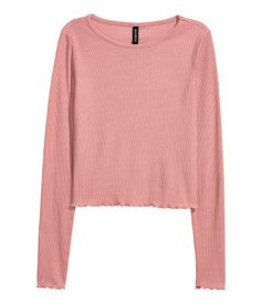 Dusty pink. Short top in soft, ribbed jersey with long sleeves and overlocked edges at cuffs and hem.