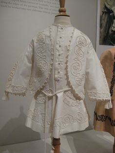 2012-08-25 KSMF - Child's white pique coat with attached zouave-style jacket and cord belt, circa 1855.