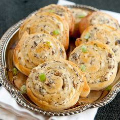 Cheesy mushroom pinwheels - an easy hors d'oevure using a refrigerated pizza crust as a shortcut and containing mushrooms, green onions, and cream cheese.