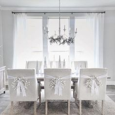 The distressed chandelier is from Visual Comfort