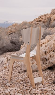 A chair design by Desert Alchemy, a furniture design studio in Salt Lake City. This chair combines sheet metal and birch plywood.
