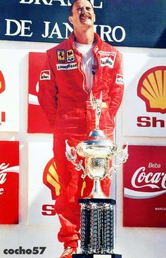 Nigel Mansell wins his first Grand Prix for Ferrari at his first race for the Scuderia. Brazil 1989. He subsequently cut his hand on the winners trophy on the podium.