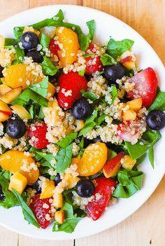 Quinoa salad with spinach, strawberries, blueberries, peaches, mandarin oranges