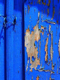Weathered painted door, via Flickr.