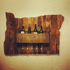 this with the background cut out in the shape of TEXAS.......hanging wine rack made from recycled pallets and other reclaimed wood.