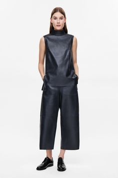 COS image 1 of Sleeveless leather top in Navy