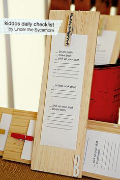 kiddo checklist by AshleyAnn.  This would be much more practical for us.  Love the blanks to change it up daily.