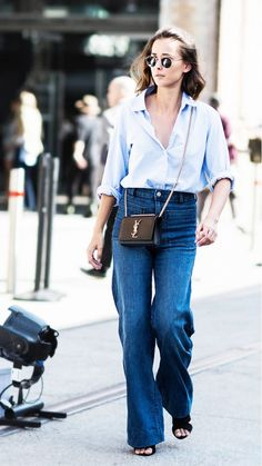 Pair a disheveled menswear-esque shirt with wide-leg jeans, minimal black heels, round sunglasses, and a black leather mini bag