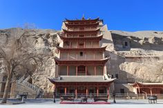 Mogao Caves (begun fourth century AD). also known as the Thousand Buddha Grottoes, form a system of 492 temples 25 km southeast of the center of Dunhuang, an oasis strategically located at a religious and cultural crossroads on the Silk Road, in Gansu province, China.