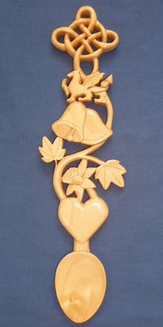 Wedding bells, dragon, daffodil and knot love spoon The dragon is the national symbol of Wales and represents protection. The leaves show a growing love and the knot symbolises the joining together of two people in marriage(bells). Carved Spoons, Wooden Spoons, Celtic Heart, Celtic Knot, Symbol Of Wales, Welsh Love Spoons, Chip Carving, Scroll Saw Patterns, Celtic Designs