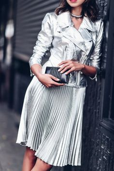 Ways to Wear Velvet With VivaLuxury - A high-shine head-to-toe look in a silver leather jacket and matching pleated skirt.