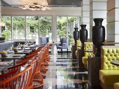 Viceroy Miami, Miami. Designer Kelly Wearstler used a color palette of spicy orange, slate gray and chartreuse to create a dramatic backdrop for Eos's Restaurant.