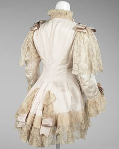 Dressing Jacket 1885 Featured, is an excellent example of a dressing jacket from the period of the late to the The combination of the ribbon and lace add an elaborate touch which is very typical of fashions from this time. 1880s Fashion, Edwardian Fashion, Vintage Fashion, Historical Costume, Historical Clothing, Vintage Gowns, Vintage Outfits, 19th Century Fashion, Moda Vintage