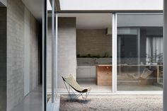 Ruxton Rise Residence is a minimalist home in Melbourne, Australia by studiofour based on the clients most important values: family, health and integrity.
