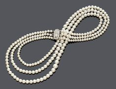Lot 2209. Natural pearl necklace, ca. 1900. Estimate CHF 100 000 / 150 000 (€ 92 590 / 138 890). Photo Koller  Clasp platinum, total 59g. Three graduated strands with 245 slightly cream-coloured and cream-coloured natural pearls of 4 to 8,3 mm Ø, joined by an oval clasp set with 2 circular-cut diamonds totalling ca. 1.30 ct. L ca. 42 cm.  With SSEF-Report no. 84093, February 2016.