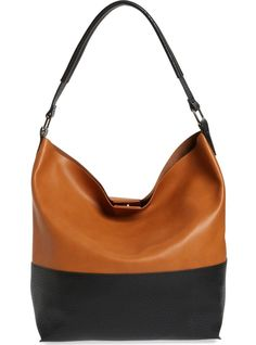 This two-tone faux-leather hobo bag serves as a casually sophisticated everyday essential.