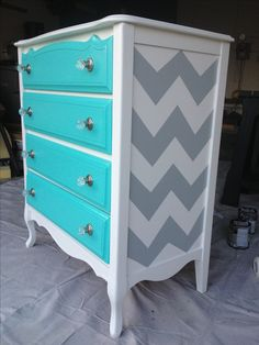"""Second hand find turned fabulous with """"Pool Blue"""" from Pottery Barn on the drawers (I had Home Depot custom match the colour from a fabric sample) and grey chevron on the sides. This beauty was someone else's trash and I turned it into a new treasure for my daughters bedroom.  I think I'm in love!!"""