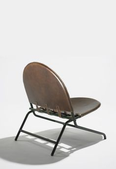 sold by Wright Auctions. Ico and Luisa Parisi. lounge chair. 1951, enameled steel, leather.