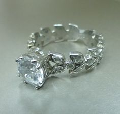 Leaf Floral Engagement Ring With Moissanite Center.