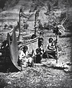 Navajo women weaving on looms.  Arizona,  1873