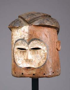 Africa | Helmet mask from the Kwese people of DR Congo | Wood, red and white pigment, black paint and kaolin.