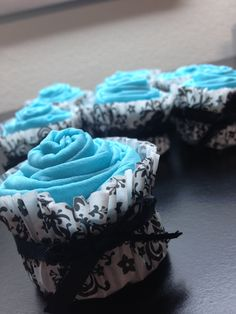 I made my signature hair scarves in Tiffany Blue and turned them into cupcakes as favors for the Breakfast at Tiffany's baby shower. Baby girl's name is going to be Audrey! How cute!