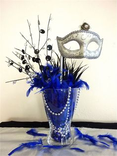 Image result for feather masquerade party centerpieces