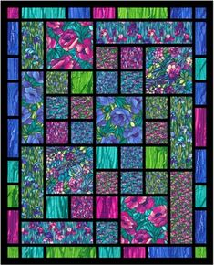 Beautiful quilt, I love the stained glass look. ..shabby fabrics.com