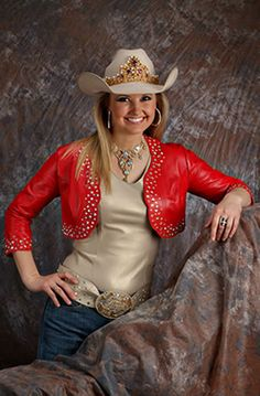 Amy Wilson, Miss Rodeo America 2008,is wearing a red lambskin bolero over a champagne pearlized lambskin camisole with matching belt.D'Anton Leather Co.