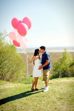 Gender reveal shoot outdoors with balloons