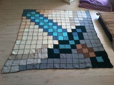 I love Minecraft, so I made a blanket pattern (patchwork-style) based on one of my favourite items in the game, the diamond sword. I knitted and sewed it myself, it is the biggest project I have undertaken all on my own and finished! Minecraft Blanket, Minecraft Quilt, Minecraft Crochet, Minecraft Mobs, Crochet Granny, Knit Crochet, Afghan Crochet, Crochet Squares, Granny Squares