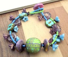 Handmade bracelet by me using the following components:    Handmade lampwork focal  Handmade lampwork discs  Czech glass  Old new stock vintage