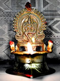 A Hindu Oil Lamp with a God/Goddess craved into the back of the lamp stand. A very unique and cultural based piece of furniture. Brass Diyas, Silver Pooja Items, Home Temple, Amazing India, Puja Room, Brass Lamp, Gods And Goddesses, Oil Lamps, Vintage Engagement Rings